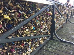 A bridge covered entirely in padlocks