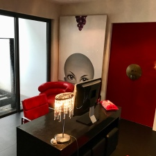 The weird office bit, complete with creepy painting