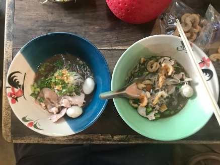 Both bowls of my noodles, the bowl on the right after I added stuff and stirred it